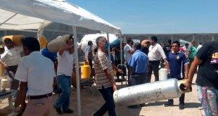 Riña de gaseros por rellenar cilindros en San Agustín Tlaxiaca