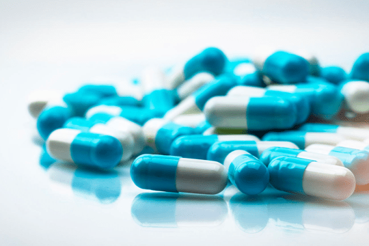 photo of blue and white capsules
