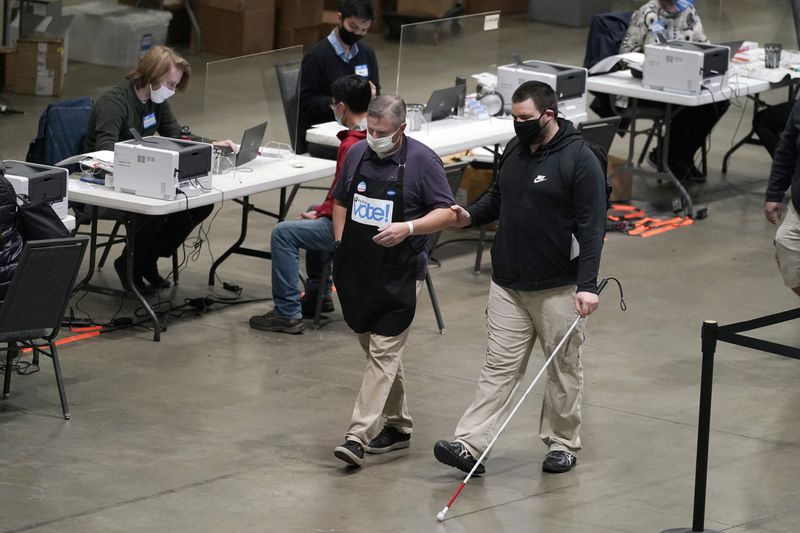 photo man with sight disability walking in a voting facility