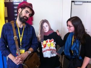 Con attendees with a standee of Amy Pond wearing a GGC t-shirt