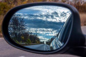 highway in side view mirror