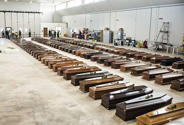 Coffins in the Lampedusa airport hangar