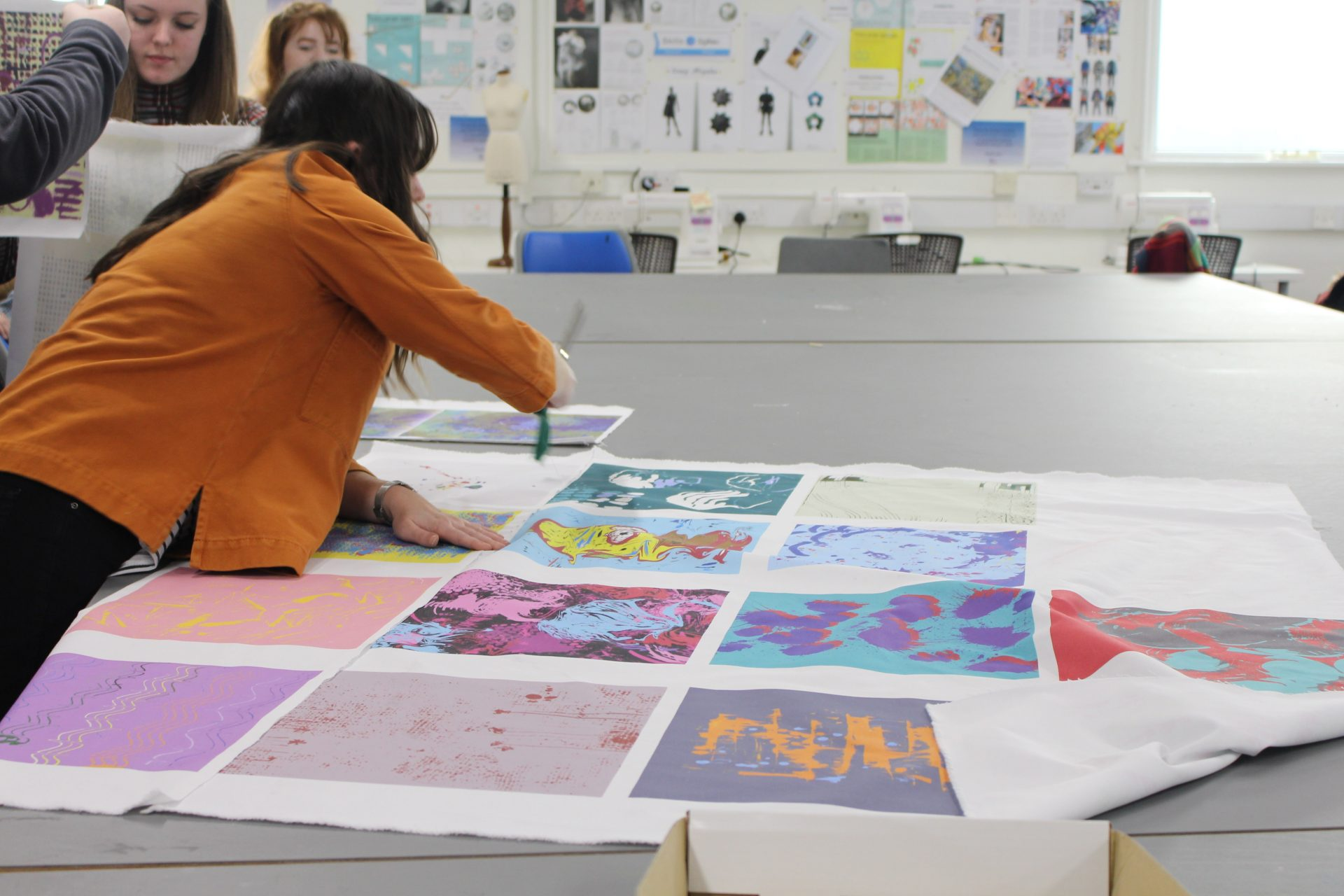 Textile masterclass at Gower College Swansea. Participant cutting printed fabric.