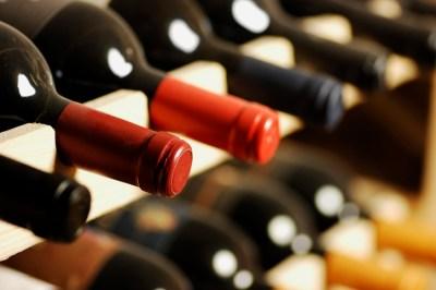 Wine bottles stored in a shelf.