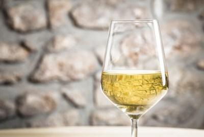 White wine glass in restaurant.
