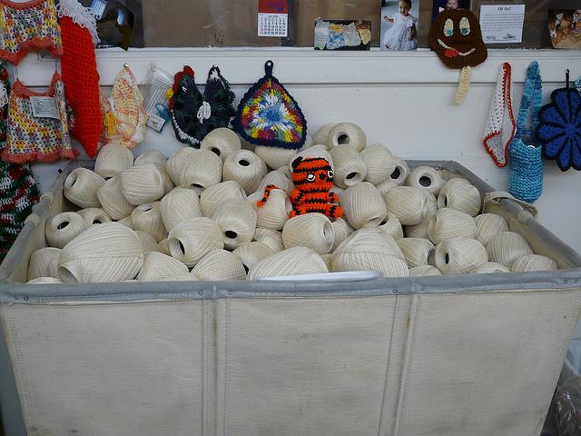 crochet tiger in bin of cotton thread
