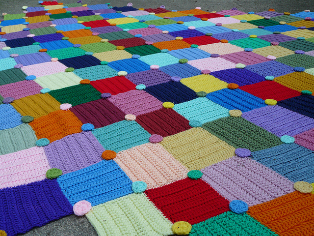 Detail of the Sistine Crochet Afghan composed of crochet squares and crochet circles