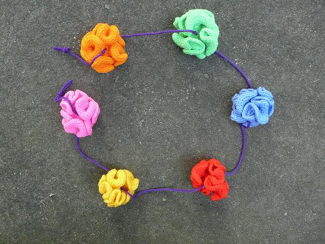 a rainbow swag of hyperbolic crochet planes