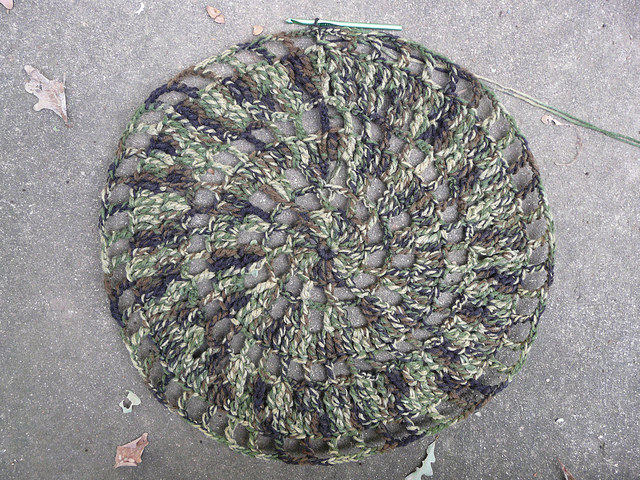 I crochet like time is of the essence and finish the first 9 rounds of the camouflage circle jacket