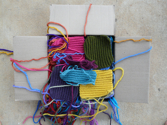 My box of squares to be unraveled (after I unraveled 11 squares) as I prepare to take one step back