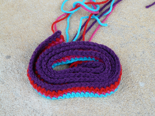 a multicolor single crochet purse strap
