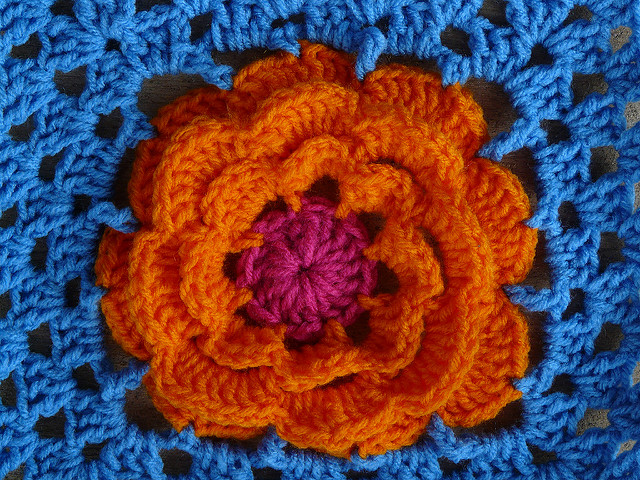 Detail of my first of seven crochet flowers and permutations