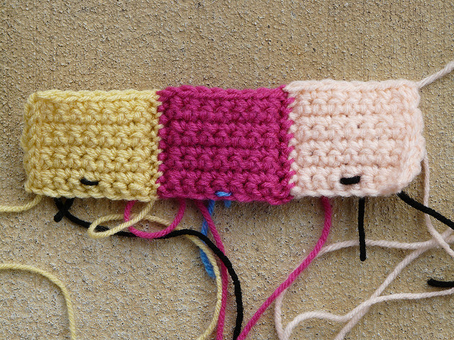 The front of three Bauhaus crochet blocks joined into rows