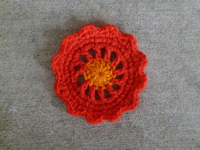 Crochet circle motif at center of crochet square