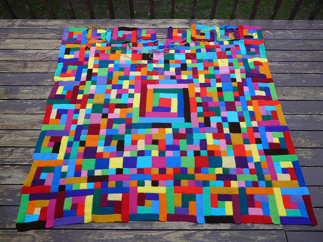 my nearly completed crochet quilt made from multicolor crochet squares and crochet rectangles