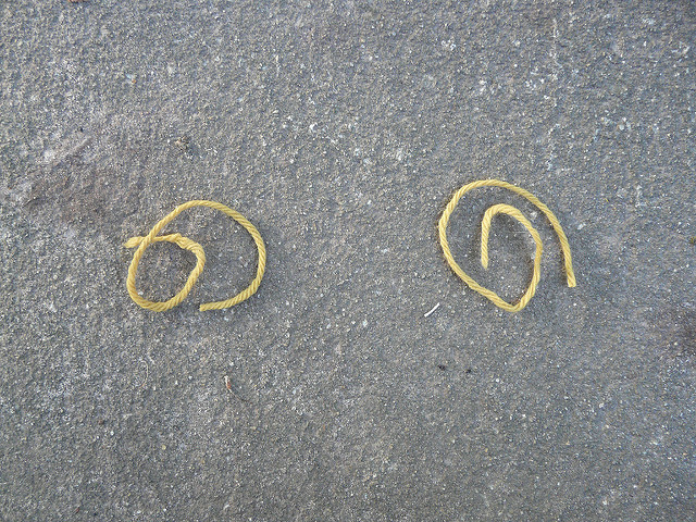 I start day 6 by testing two strands of yarn to be used in a burn test. Both strands are presumed to be wool