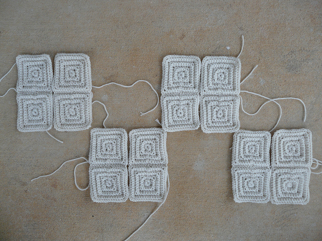 Sixteen small textured crochet squares I finished after sunset