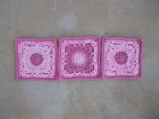 three pink crochet squares