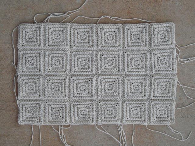 twenty-four small textured crochet square motifs