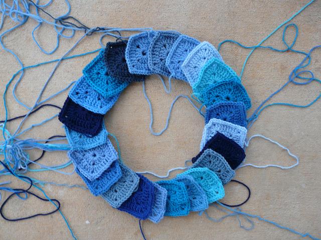 A circle of crochet squares