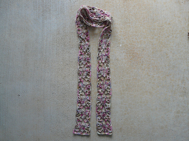 Crochet scarf with a heart motif