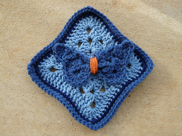 Crochet square with a crochet butterfly appliqued to the top