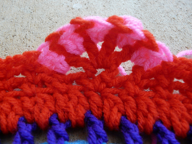 The edge of the crochet table cozy before the trumpet lesson