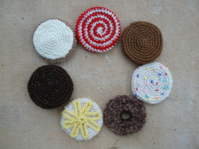 Seven of the 13 crochet cookie designs needed for the cookieghan on a s-l-o-w crochet day