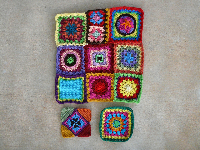The nearly completed center panel of a crochet blanket at the end of the day errands ate