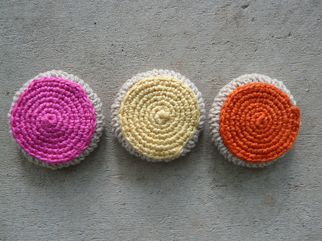 three frosted crochet cookies