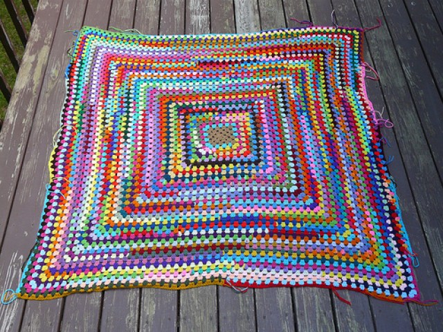 My great scrap yarn granny square with most of the ends woven in inspiring me to greater things