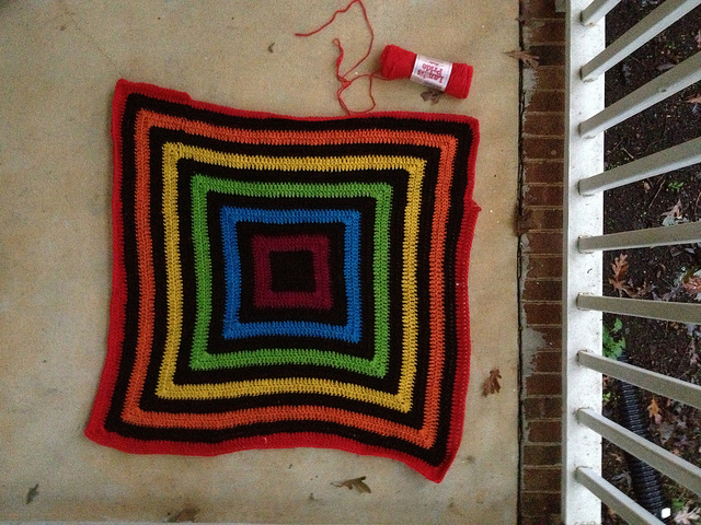 A view of the nearly finished body of the future felted fat bag on a dark and rainy day