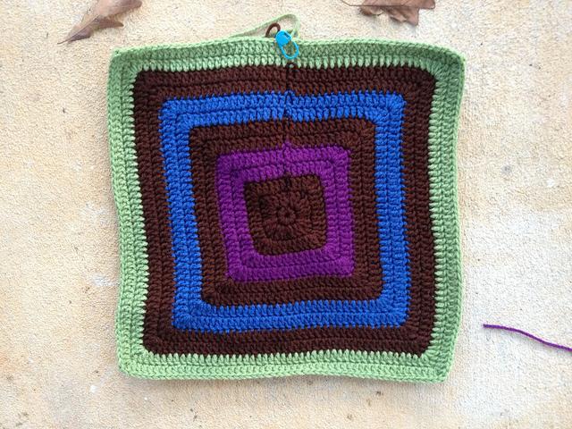 I continue work on a future unfelted granny square fat bag