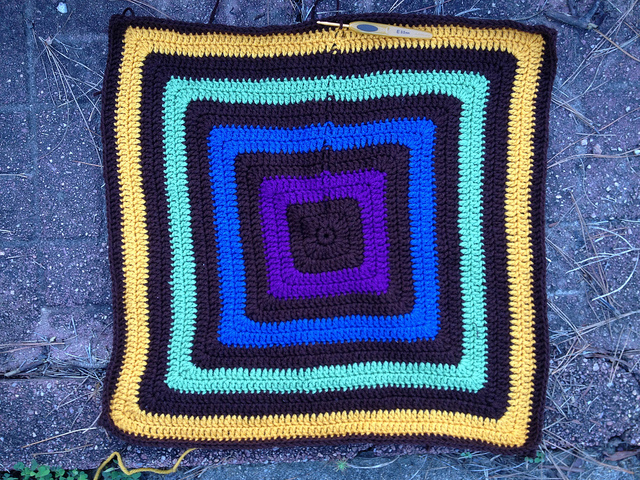 Outside forces spur me to crochet the future granny square fat bag to within five rounds from completion