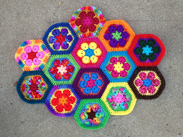 fourteen African flower crochet hexagons joined with a whipstitch