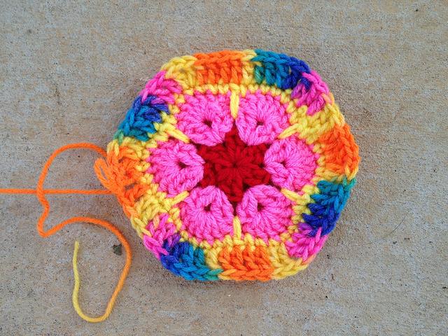 An African flower crochet hexagon with a variegated border