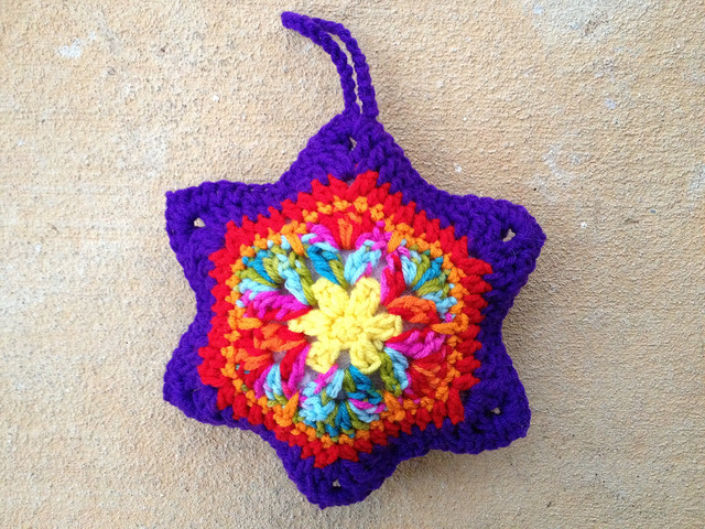 The completed six pointed african flower crochet ornament