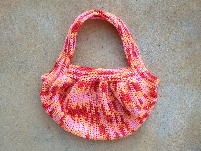 A wool crochet fat bag ready to felt