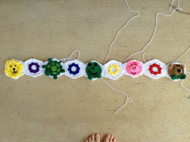 a project with textured crochet flower hexagons and animal crochet hexagons