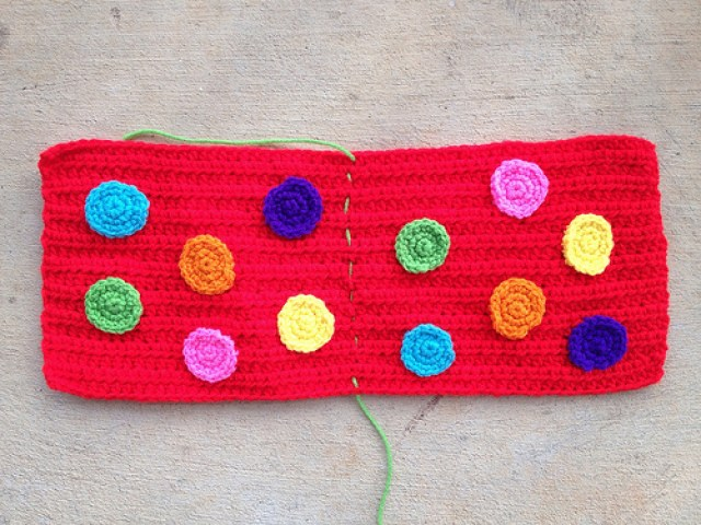 I applique the 12 crochet dots to the body of the red hot pocket purse