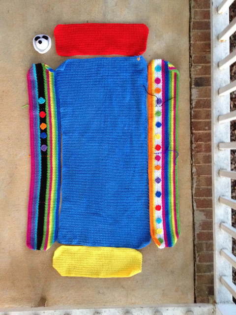 the pieces of my Project Linus crochet blanket laid out for review