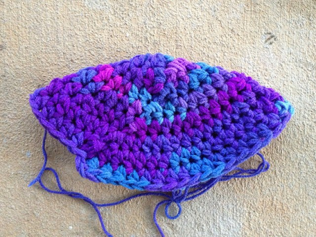 A purple crochet hat