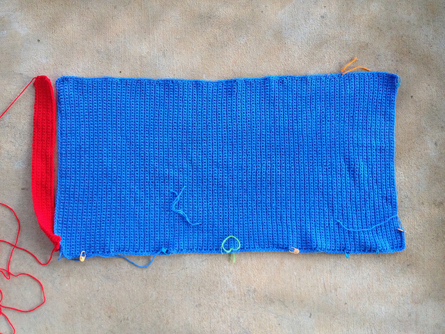 blue crochet panel with a red crochet border piece