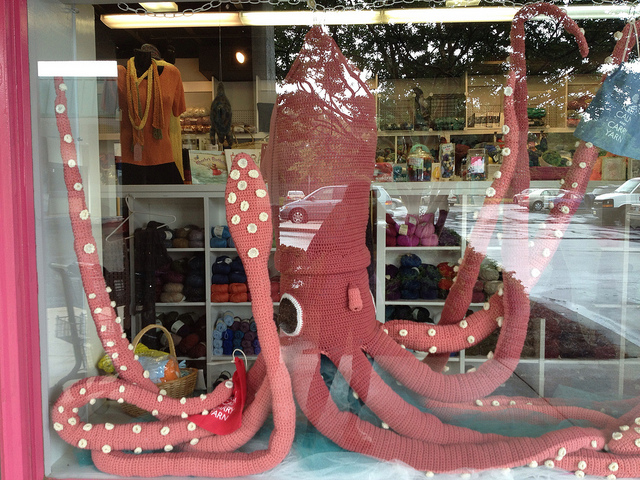 large crochet squid in the window of a local yarn store