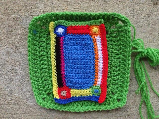 the crochet mini-meta afghan applique on a crochet corner of the project linus crochet blanket