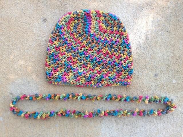 silk crochet chemo cap with a matching crochet lei
