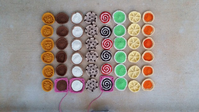 forty-eight crochet cookies arranged in a bar graph