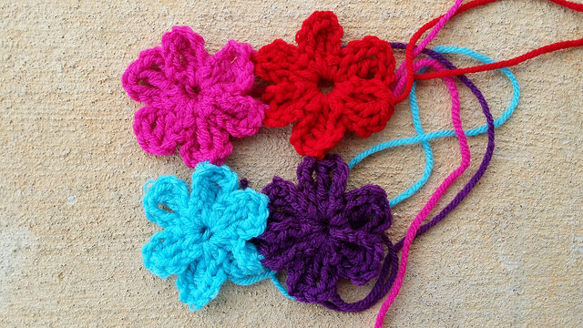 Four crochet flowers of the sunshine, shadow, and flowers