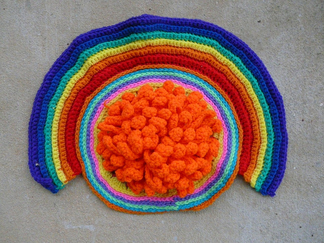 One of the ghosts of projects past: a huge crochet chrysanthemum under a rainbow