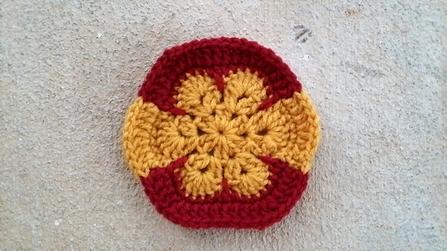 Crochet hexagon inspired by the flag of Spain for a crochet soccer ball